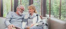 older couple comfortable at home