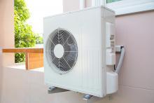 heat pump outside of home springtime