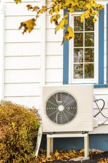 heat pump outside house in fall