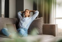 woman relaxed on couch in home