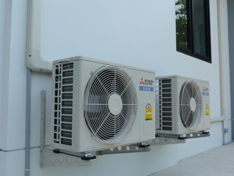Mitsubishi Mini Split Heat Pumps outside of a home