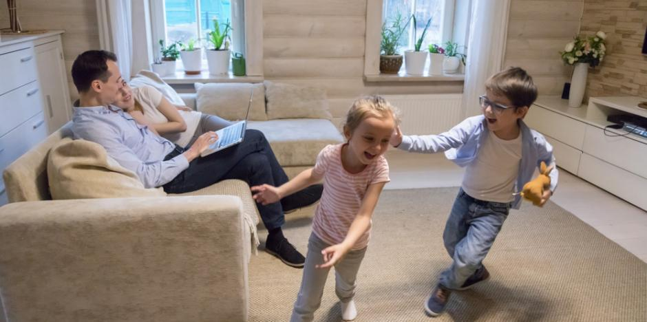 family of 4 enjoying an evening playing in the living room