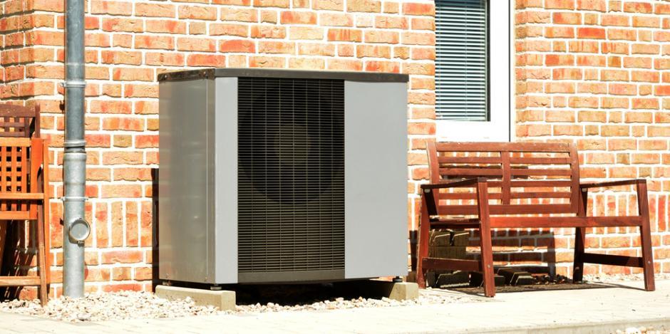 heat pump unit outside brick house