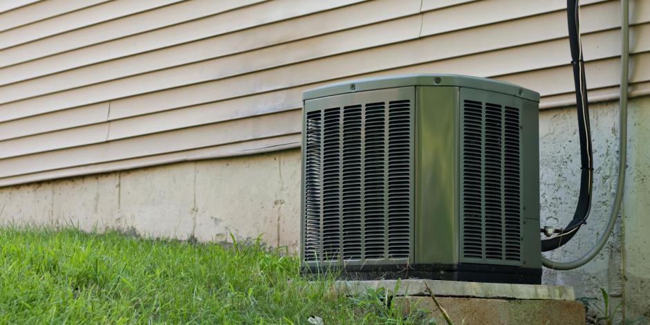 heat pump on lawn Kearney HVAC